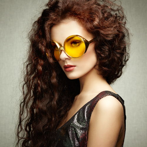 Portrait of beautiful woman in sunglasses on white background. Fashion photo